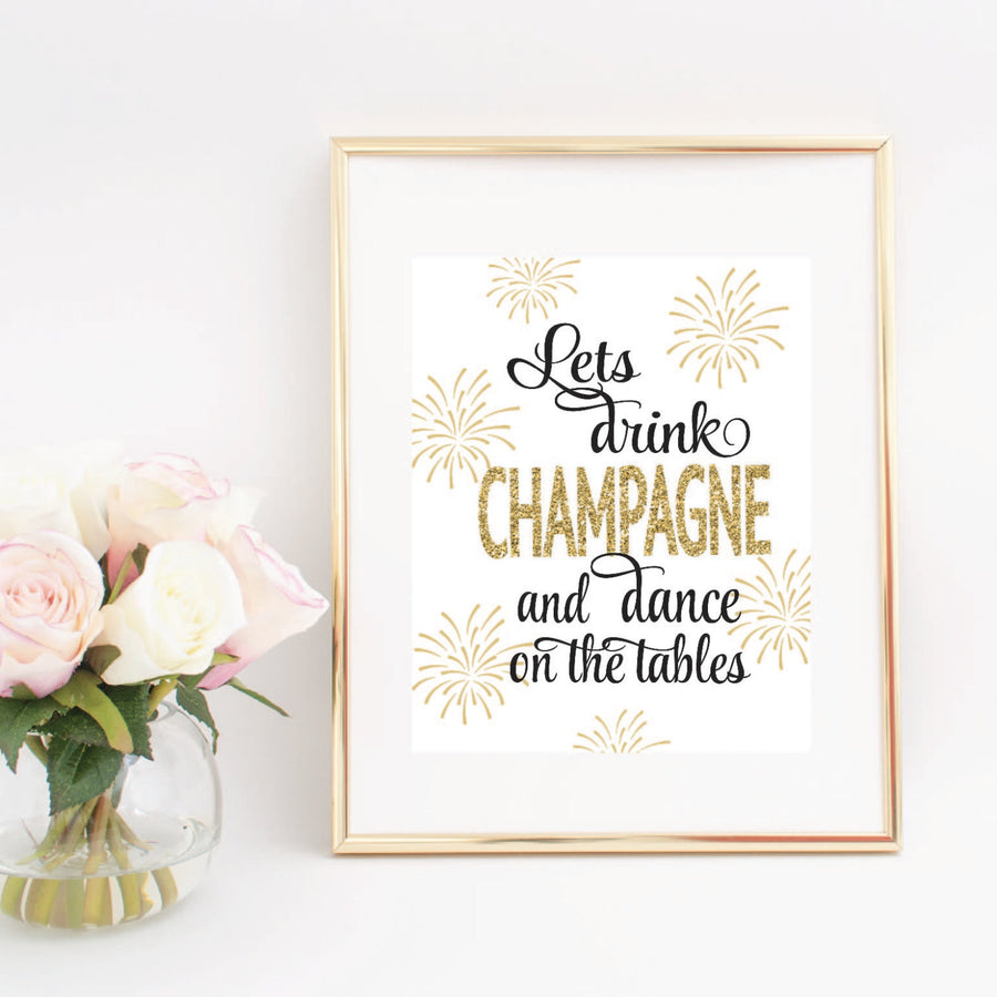 Let's Drink Champagne And Dance On The Tables digital download printable image in a gold frame beside a vase of pink flowers