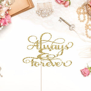 always and forever sparkle cake topper on a wedding themed background featuring a comb, key, envelopes and beads.