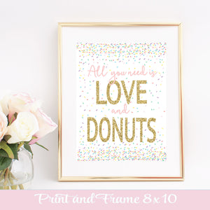 All you need is love and donuts digital download shown in a gold frame beside a vase of roses