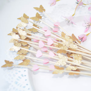 gold glitter and pink butterfly mini donut skewers