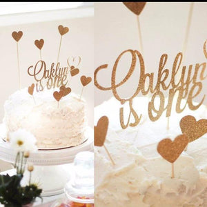 Oakley is one gold sparkle cake topper with heart cake toppers