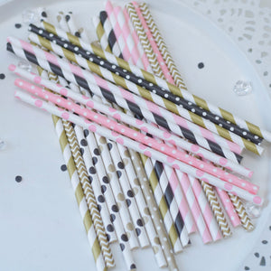 Gold and white, pink and white and black and white pile of straws