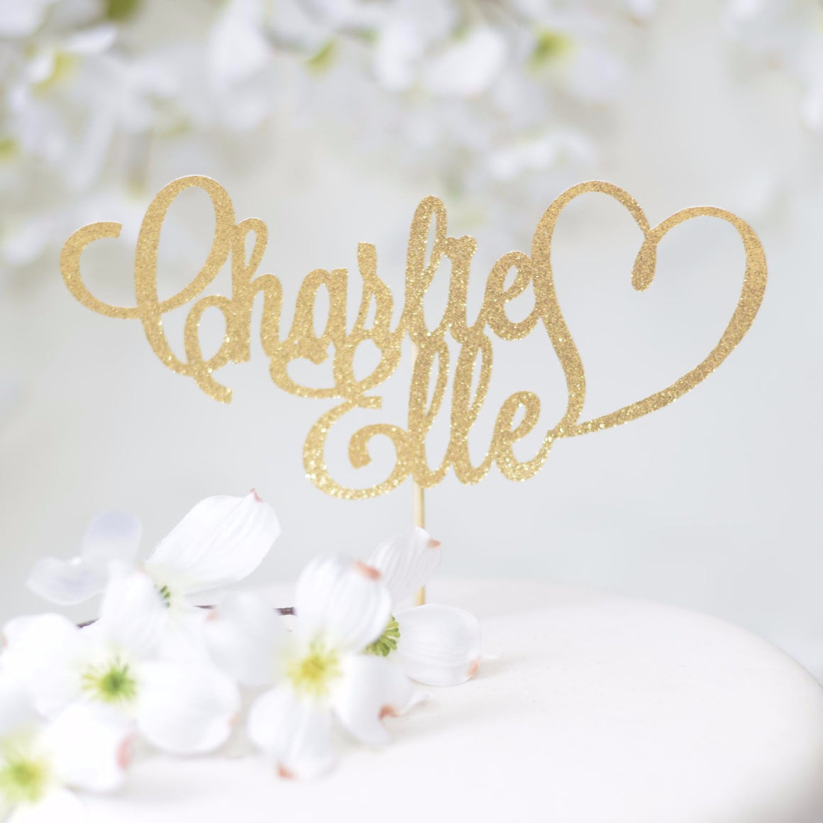 Charlie Elle heart glitter sparkle cake topper on white floral cake