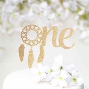 One gold sparkle cake topper with dream catcher details