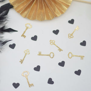 gold sparkle key decorations and black heart confetti
