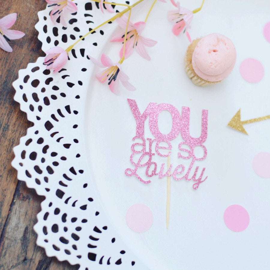 You are so lovely pink sparkle cupcake topper on white plate
