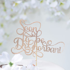 Soon to be Dr Ghorbani gold sparkle cake topper