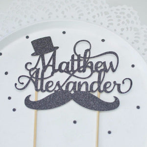 Black little gentleman cake topper with mustache and top hat details