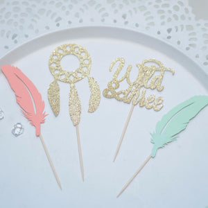 coral and mint flowers and sparkly gold dreamcatcher and wild one cupcake toppers