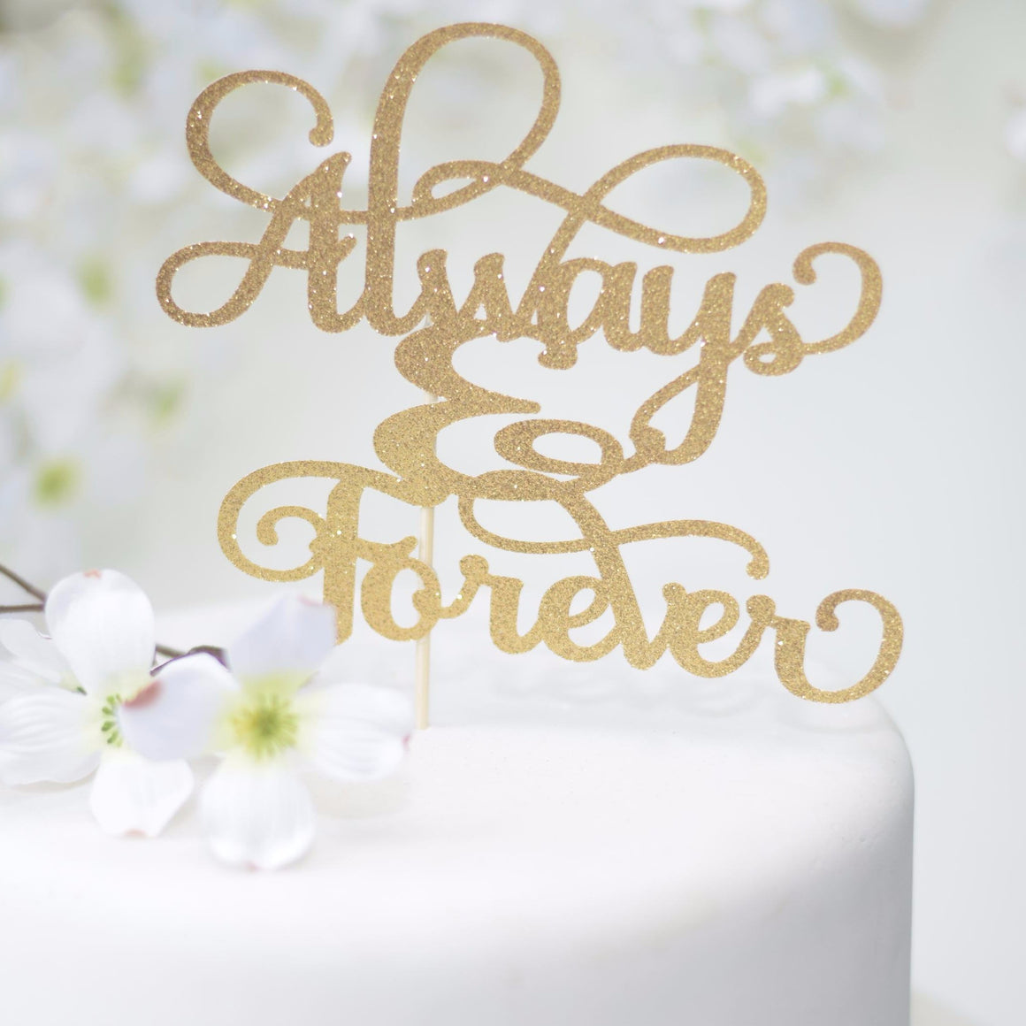 always and forever gold sparkle glitter cake topper on white cake with flower cake