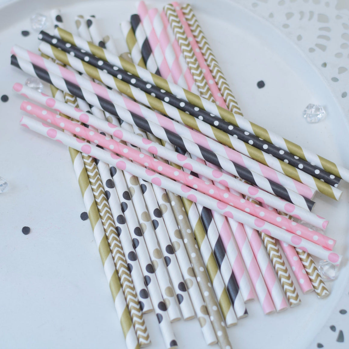 pink and white, black and white, gold and white straws