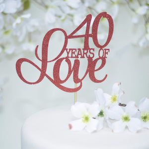 40 years of love pink glitter cake topper on floral background