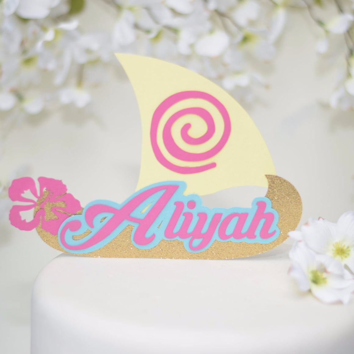 Aliyah Moana inspired cake topper with Hawaiian flowers and design