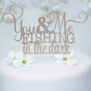 You and Me Fishing in the dark gold sparkly glitter cake topper on a wedding cake