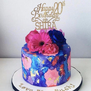 Happy 20th Birthday Shira in gold sparkly font on blue and pink floral cake from customer