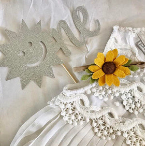 Closeup of sunshine and silver sparkle cake topper