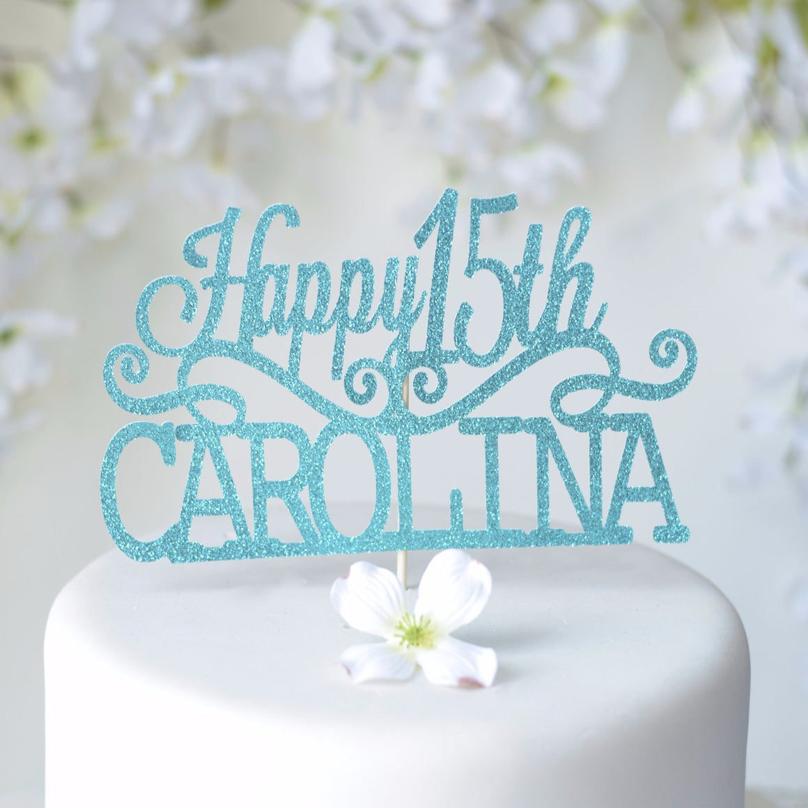 Happy 15th Carolina Quinceañera cake topper with blue and teal sparkles