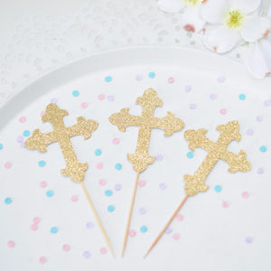 Gold Cross Cupcake toppers on a cake plate