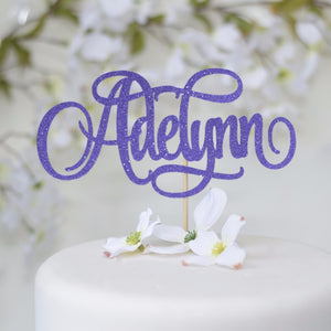 Adelynn purple sparkly giltter cake topper on white cake