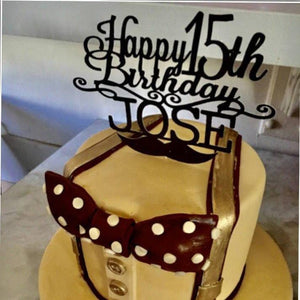 Happy 15th Birthday Jose black mustache cake topper on gold and black cake with suspenders and bowtie