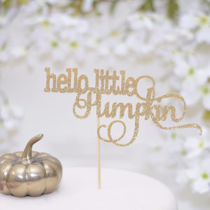 Hello little pumpkin sparkle glitter cake topper on white cake with gold pumpkin decor