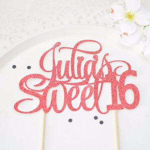 Julia's sweet 16 pink sparkle cake topper on white plate background
