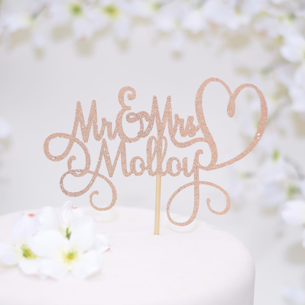Mr and Mrs Malloy heart wedding cake topper with gold sparkle details