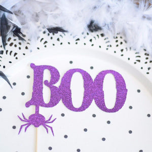Purple Boo purple glitter cake topper with spider accent on white plate