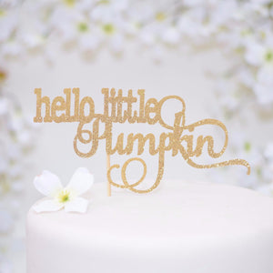Hello little pumpkin gold sparkle glitter topper on white cake with flowers