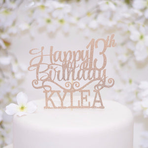 Happy 13th birthday Kylea gold sparkle glitter cake topper on white cake