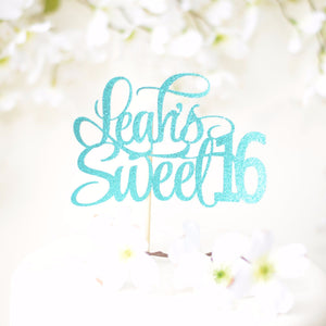 Leah's sweet 16 teal sparkle glitter cake topper on white cake with flower details