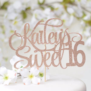 Kailey's sweet 16 rose gold cake topper on white cake with flower details