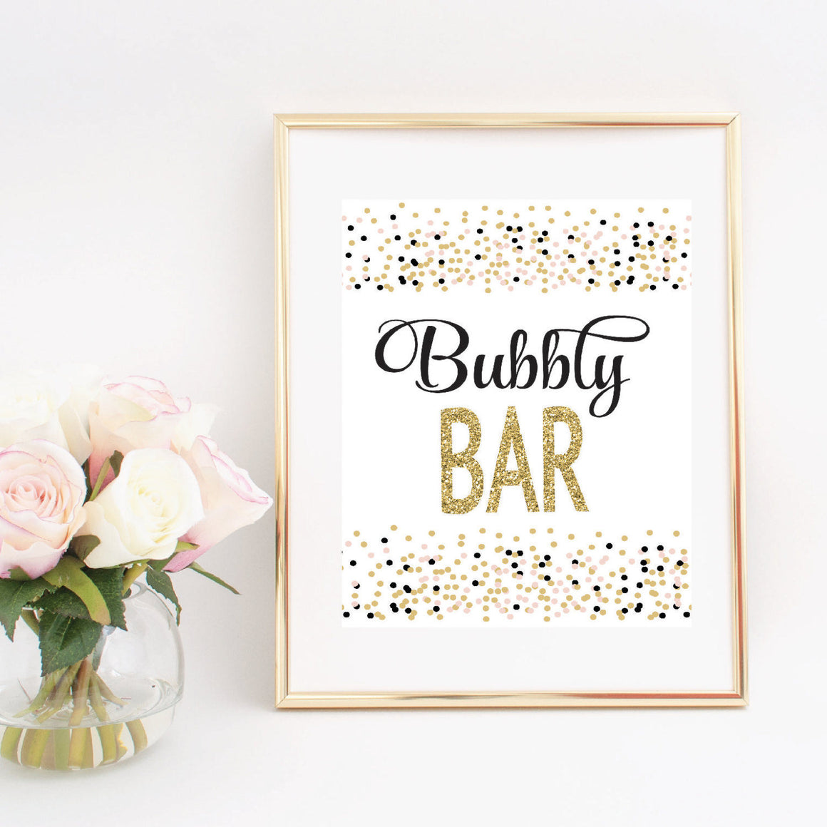 Bubbly bar digital download printable sign in a gold frame beside pink roses
