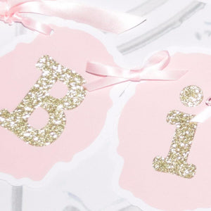 detail image of birthday banner showing the pink and gold sparkle details