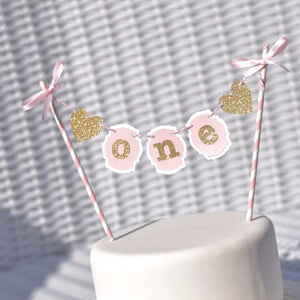 One gold sparkle and pink cake topper