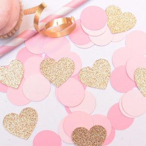 gold sparkly hearts and pink circle confetti decorations