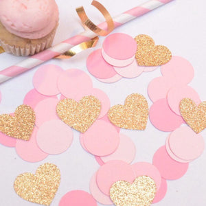gold sparkly heart decorations with pink confetti