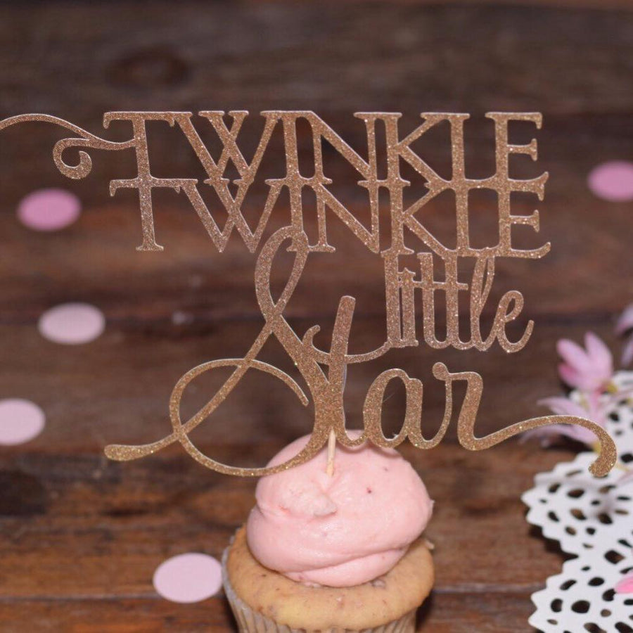 Twinkle Twinkle Little Star gold sparkle glitter cake topper on white cake with gold details