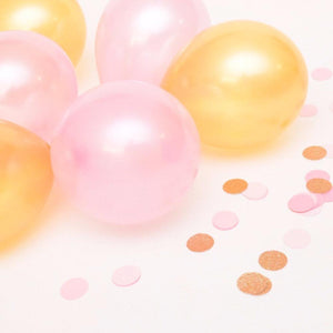 gold and pink balloons with pink confetti decorations