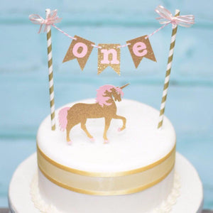 gold and pink unicorn sparkle cake topper with one in pink and gold letters