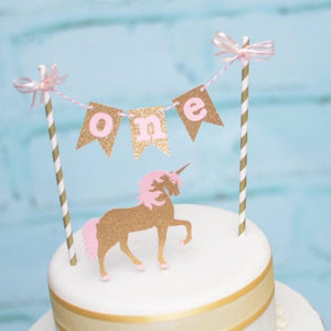 One pink and gold cake topper with sparkle unicorn
