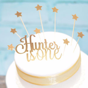 Hunter is One with stars cake topper on white and gold cake