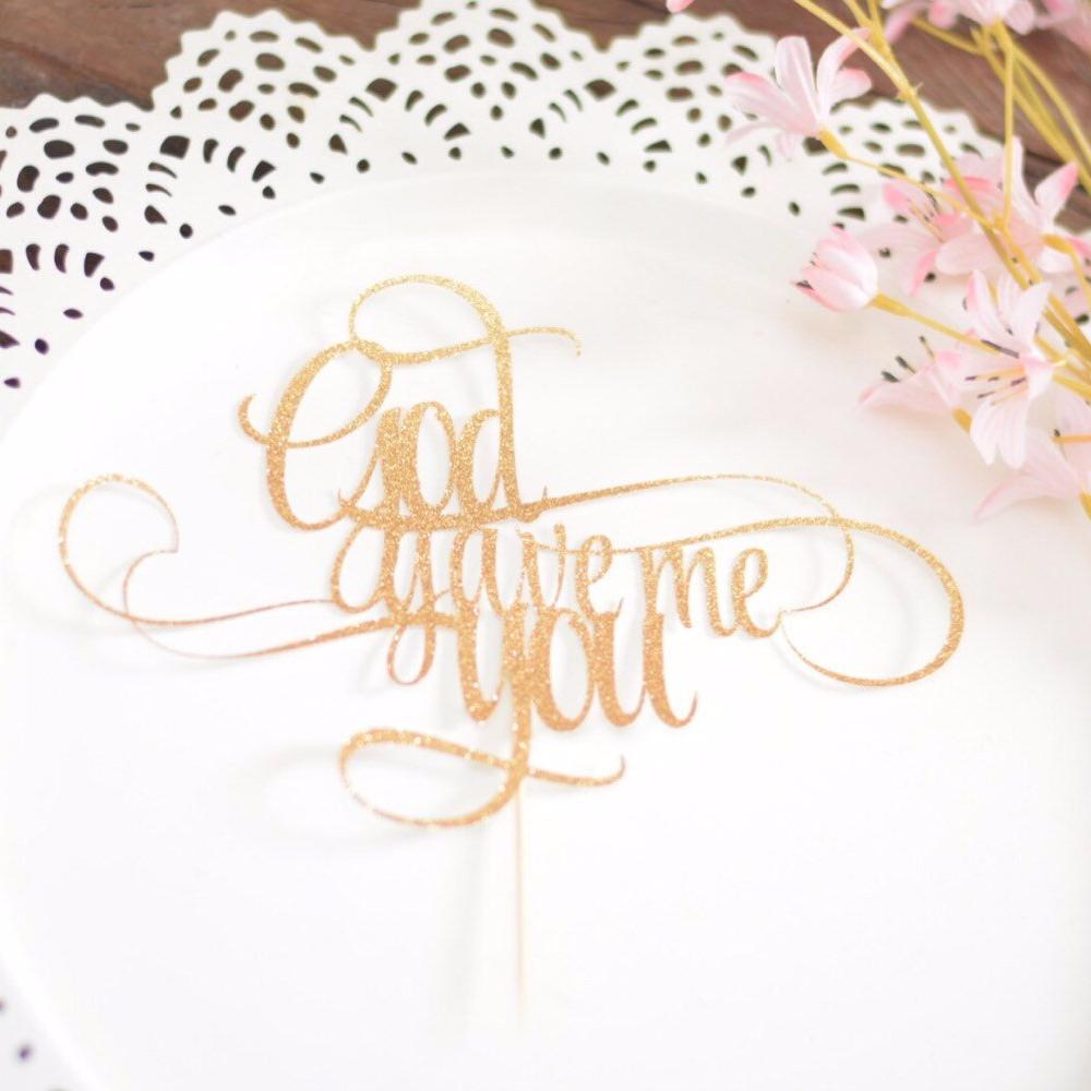 God gave me you gold glitter sparkle cake topper on white plate with pink flowers