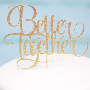 Better Together gold sparkle cake topper on white cake with blue background