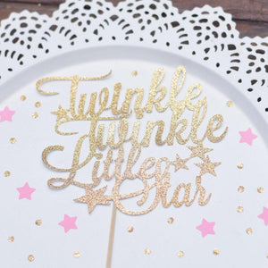Twinkle Twinkle Little Star gold glitter cake topper on white background with pink stars