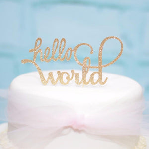 hello world golf sparkle glitter cake topper on white cake with blue background