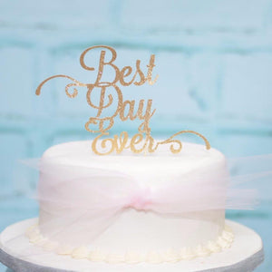 Best day ever glitter cake topper on white cake to show the size of the cake topper on a real cake