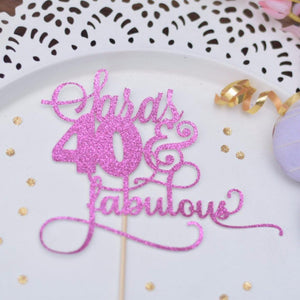 Sarah's 40 & Fabulous pink glitter cake topper on white background