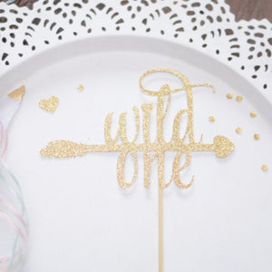 All gold sparkle cake topper that spells Wild One