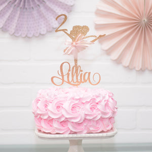 gold ballerina on pink cake